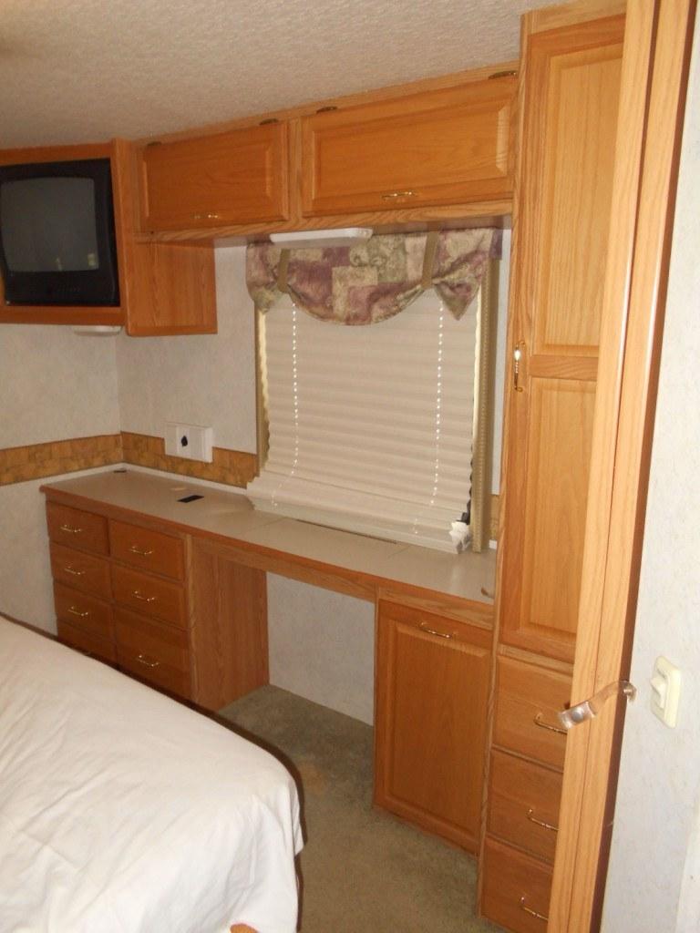 2003 winnebago adventurer 35U bedroom storage