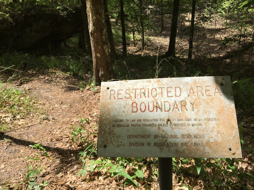 restricted sign on limestone trail.