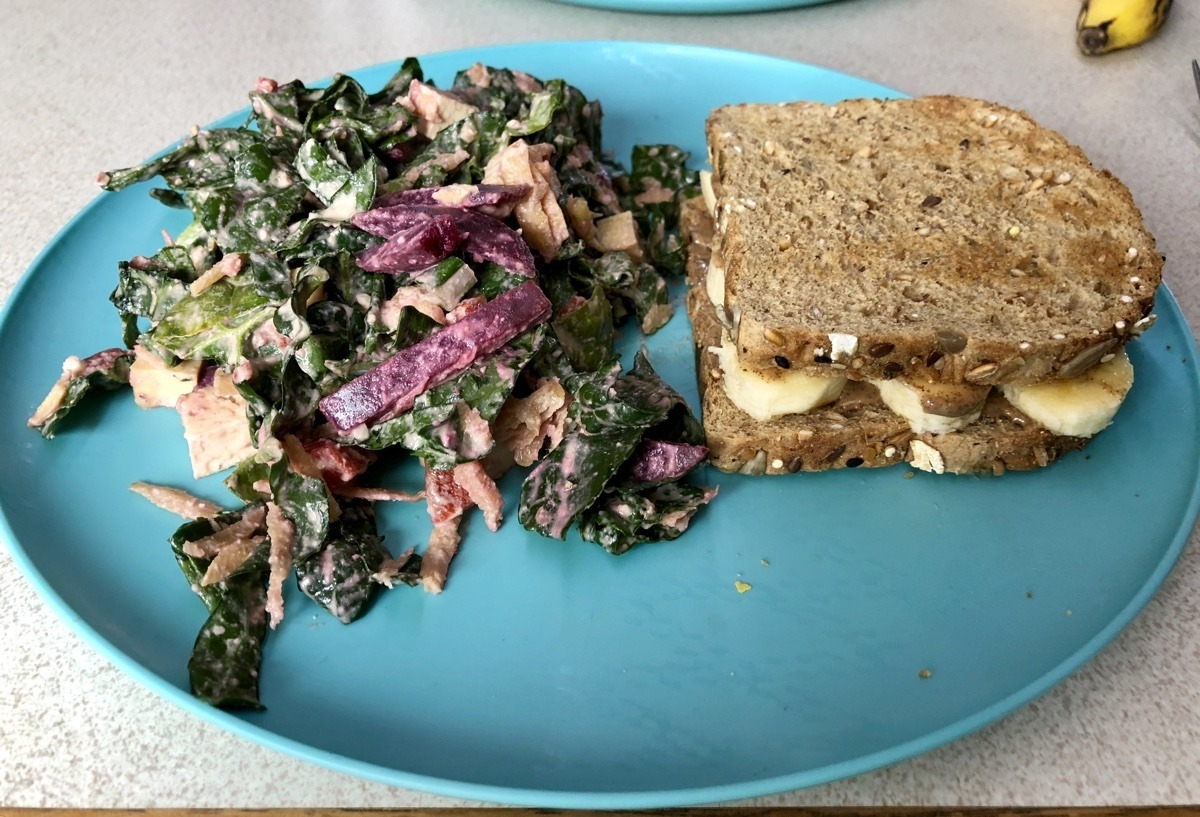 kale salad with creamy garlicky dressing and almond butter and banana sandwich.