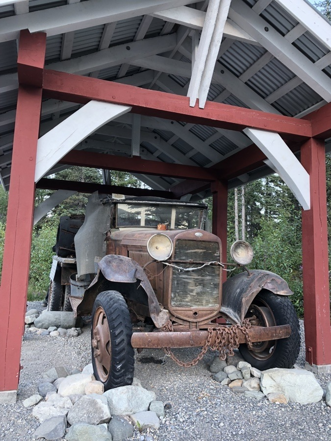 old car by the footbridge to mccarthy alaska.