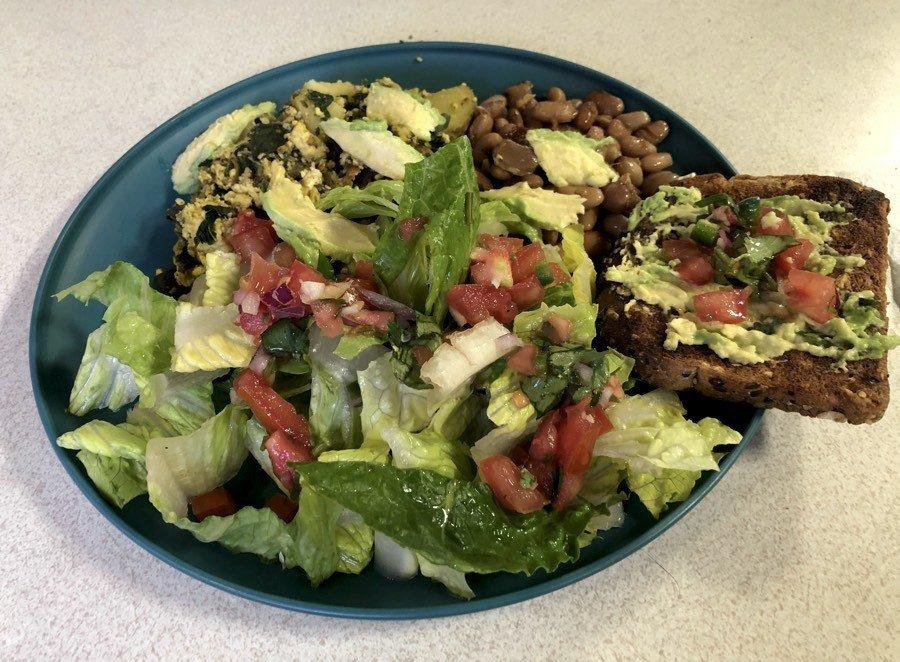 vegan tofu scramble, beans, rice, and salad.
