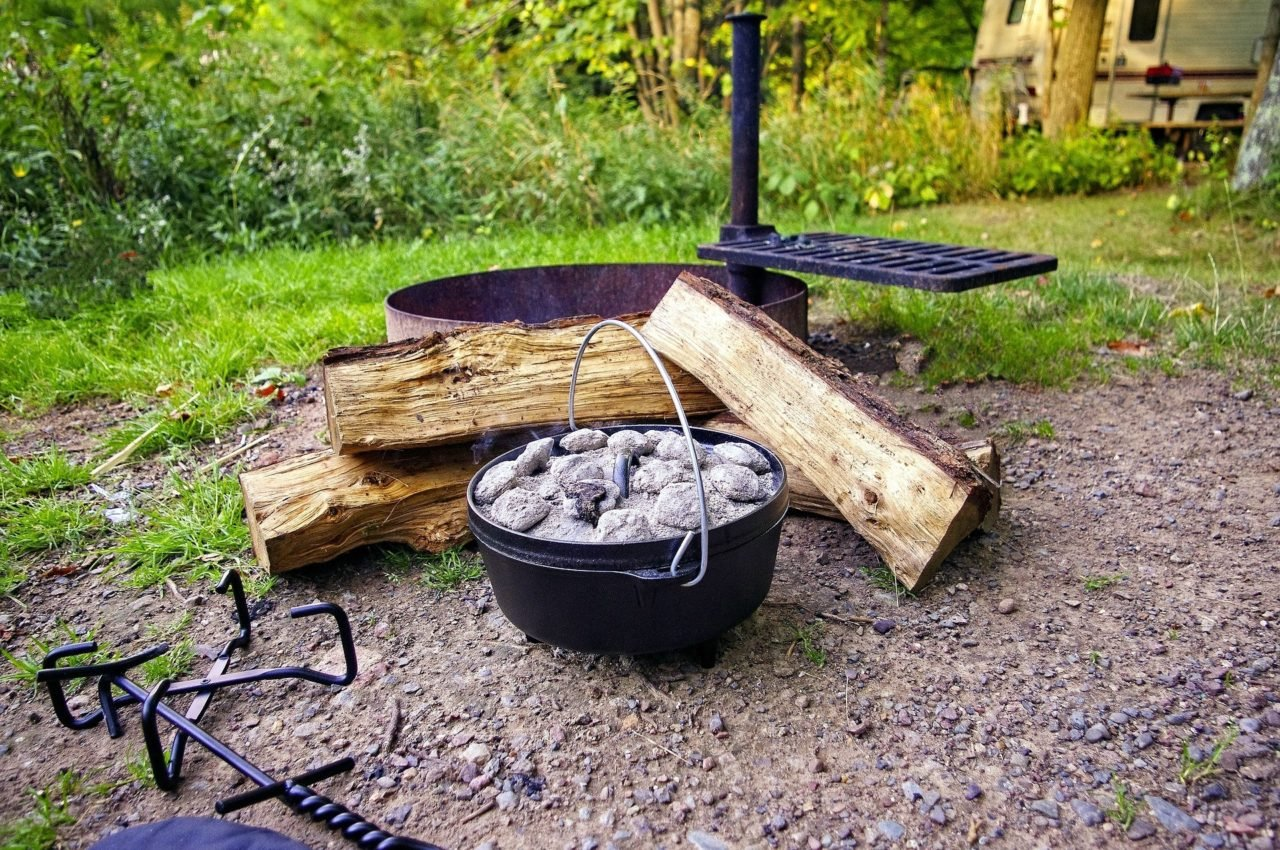 dutch oven and wood for cooking while camping.