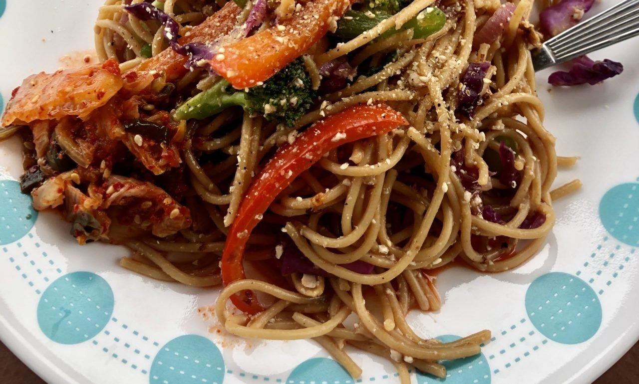 kung pao style noodles on a plate.